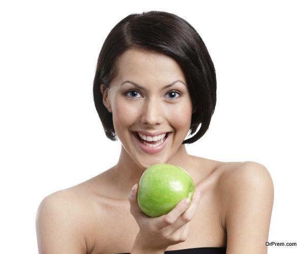 Woman hands an apple