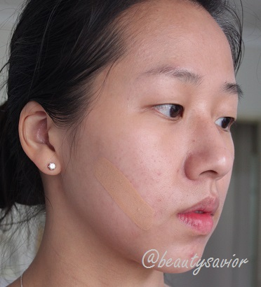 Bare face with one swipe of the foundation