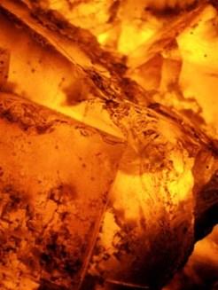 Golden amber close up backlit shows crystals