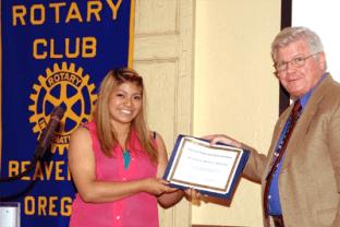 Rotarians giving scholarship award