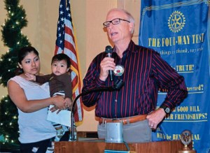 Beaverton Rotarian presents a scholarship to a young mother