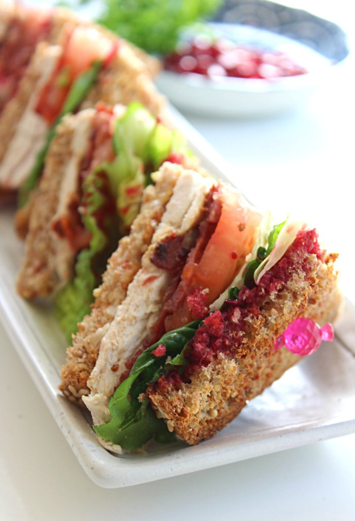 Leftover Turkey: Healthy Club Sandwich with veganaise, sprouted spread, turkey bacon and cranberry sauce.