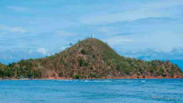 lighthouse in the mountain facing the beach in colagsing beach resort santa maria davao occidental philippines