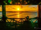 a woman is watching the sunrise in siargao