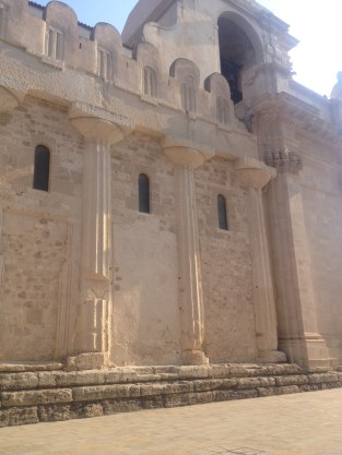 The western side showcases the original greek doric columns that were filled in to make the Cathedral.