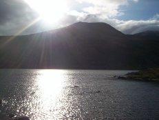 The sun sinks behind Ben More Assynt