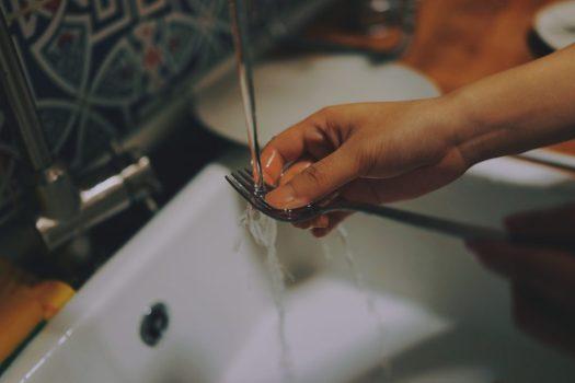 washing a fork, Photo by Catt Liu on Unsplash
