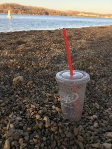 peedy cafe plastic drink cup on the shore of the Tennessee River. Someone just left it. I picked this item up this past weekend. Photo by me.