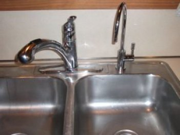 Under-sink water filter installation. Photo from instructables.com.
