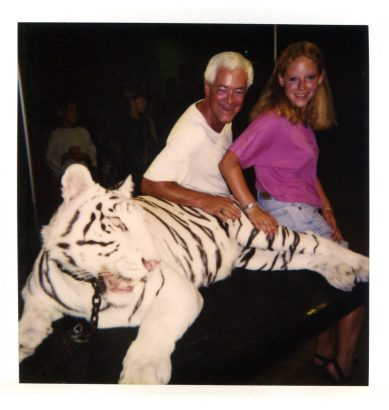 Author and her Dad sitting with a tiger.