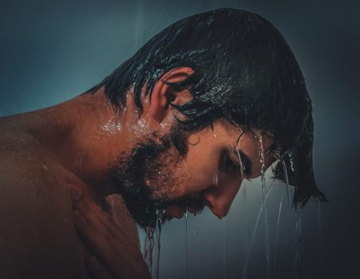 Photo of man with head under shower. Image by Olya Adamovich from Pixabay