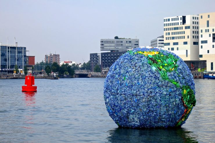 The World of Litter plastic globe in Amsterdam, floating in the water.