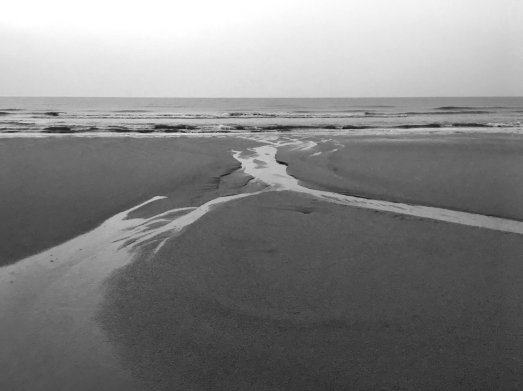 Black and white photograph of the beach. Photo by me