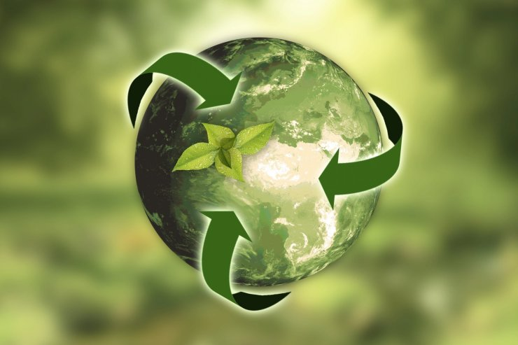 Graphic of a green Earth with green arrows flowing around it. Image by annca from Pixabay