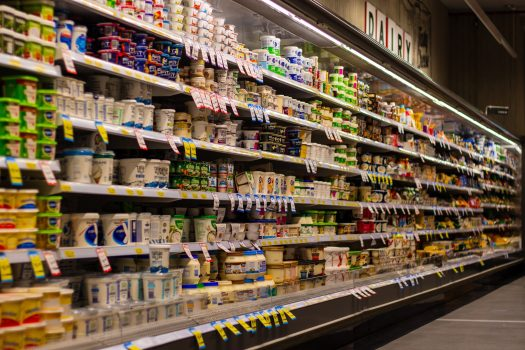 Dairy section of a supermarket, lots of plastic packaging