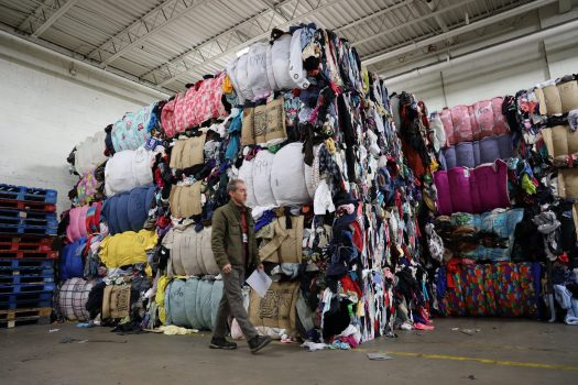 Donated clothing stacks at a Goodwill outlet being prepared to be sent to various aftermarkets.