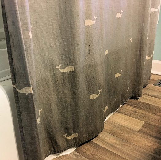 Cloth shower curtain with mildew growth