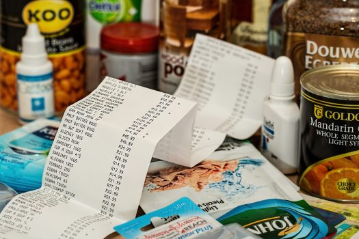 Receipt surrounded by supermarket products