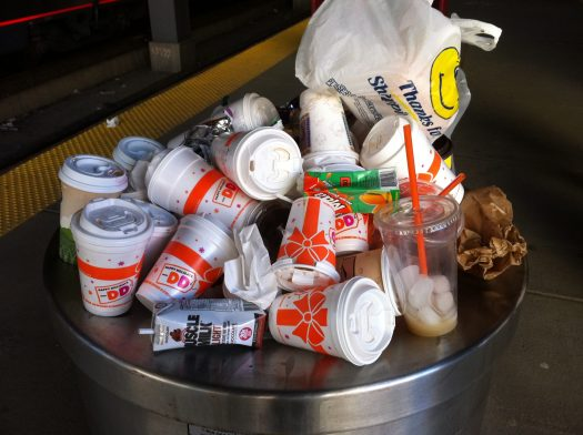 Overflowing trash receptacle at Dunkin Donuts