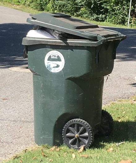 Full 96-gallon city issued garbage bin