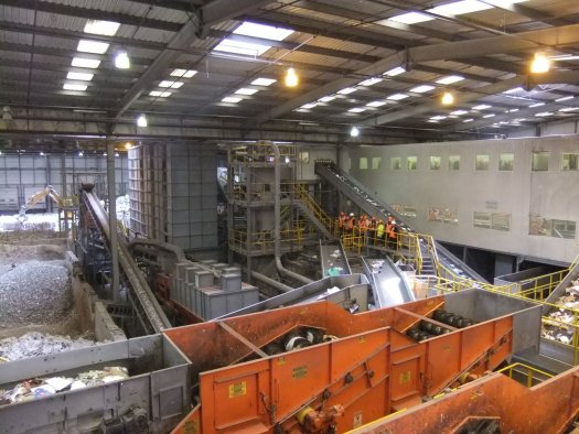 A bird's eye view of the interior of a Material Recovery Facility (MRF).