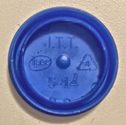Blue plastic cap from a gallon milk or water jug, #4 LDPE plastic.