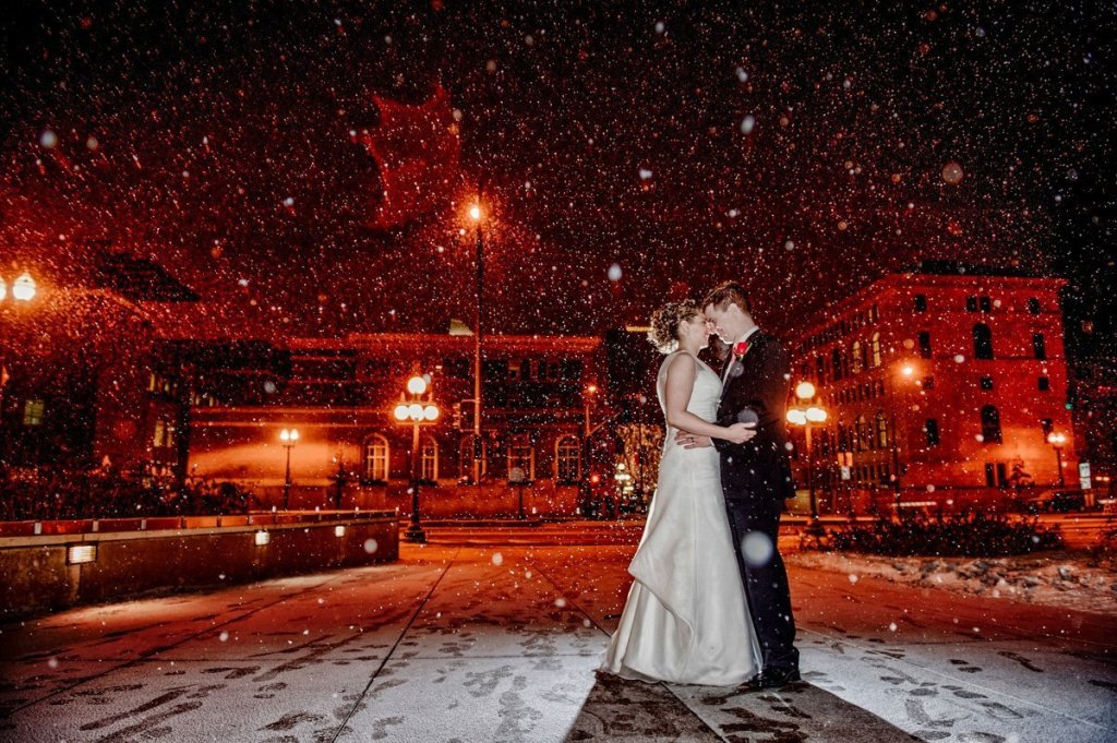 Minnesota science museum wedding bride and groom outside in snowstorm