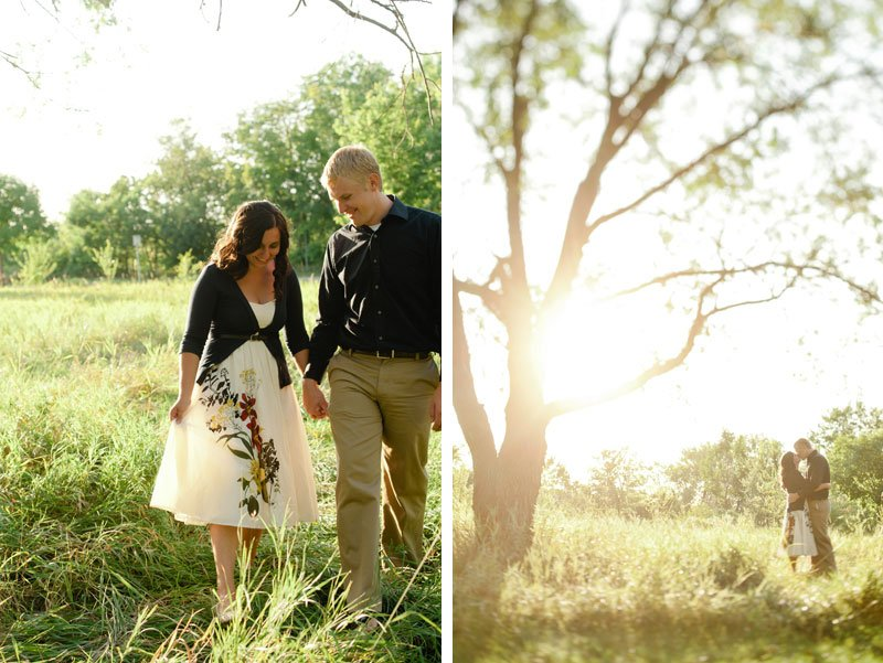 minneapolis summer engagement photos walking through a field with large tree