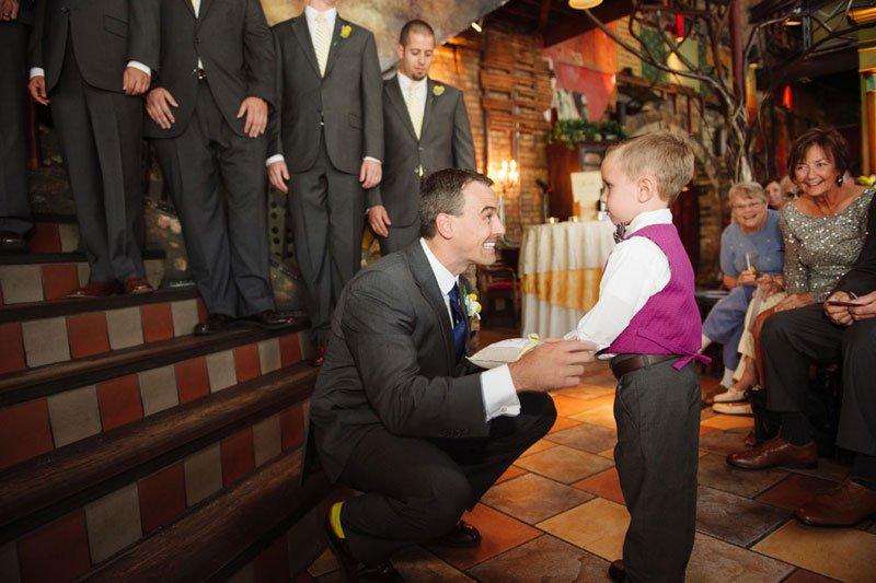 groom greets ringbearer at loring pasta bar minneapolis