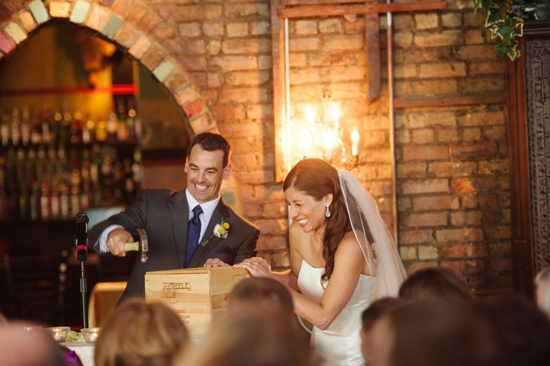 bride and groom with wine crate at loring pasta bar minneapolis
