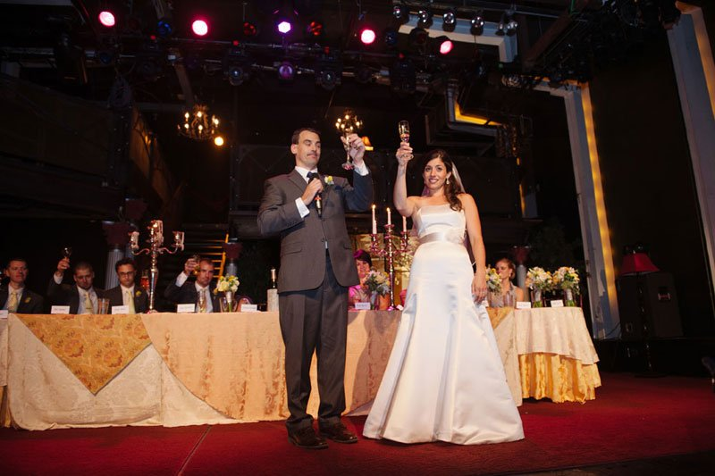 bride and groom give toast at varsity theater wedding minneapolis
