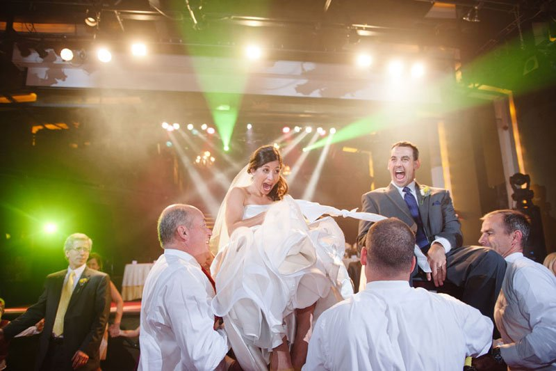 bride and groom lifted in chairs at varsity theater wedding minneapolis