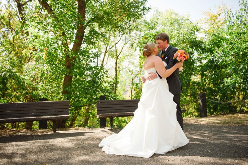 bride and groom at first look at stone arch bridge minneapolis wedding photographer