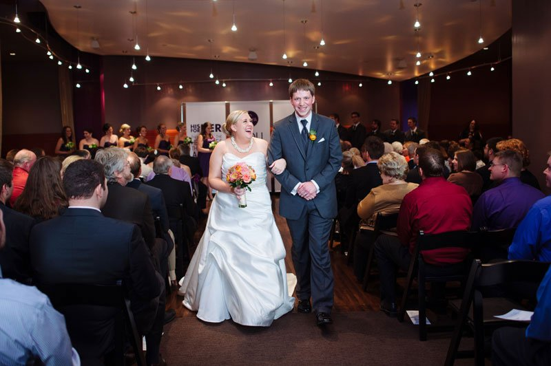 bride and groom walk down aisle after wedding ceremony five event center minneapolis wedding