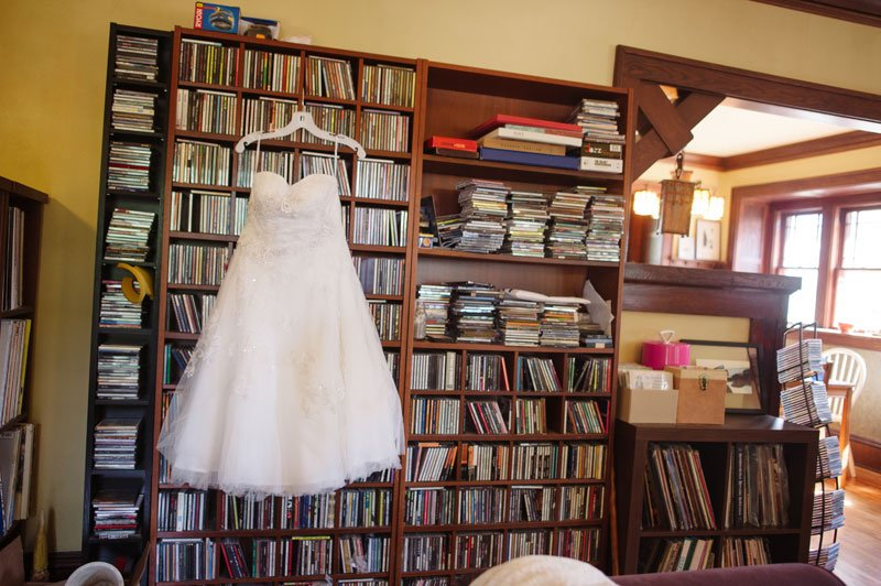 wedding dress hanging on music collection in south minneapolis home