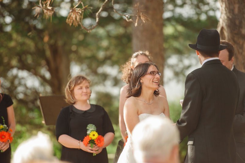 bride looks up at groom during ceremony at Lake Hiawatha in South Minneapolis