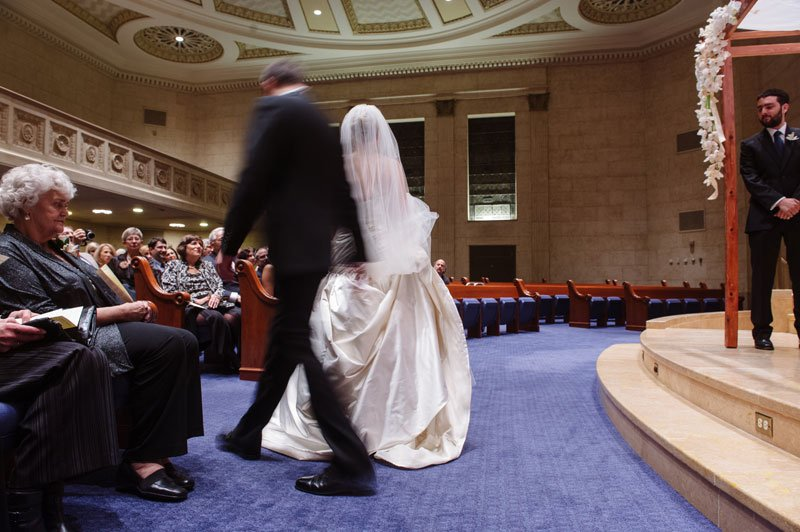 groom walks around bride during Temple Israel Wedding Minneapolis MN