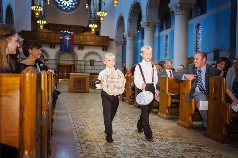 ringbearers with embroidered signs for st thomas church wedding st paul mn