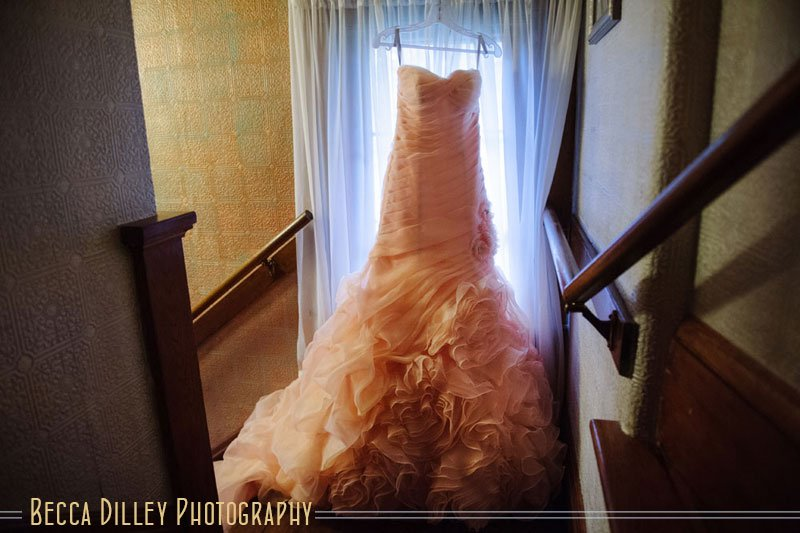 pink ruffled wedding dress in window for stillwater mn wedding