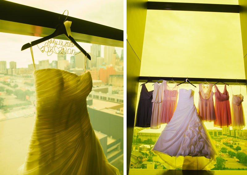 wedding gown and bridesmaid dresses hanging in yellow room at Guthrie theater minneapolis mn