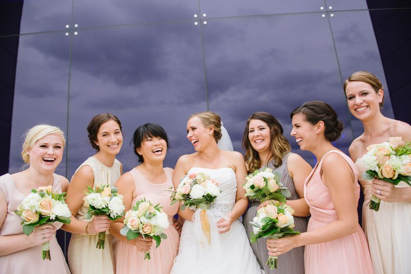 bridesmaids laughing at Guthrie theater minneapolis mn