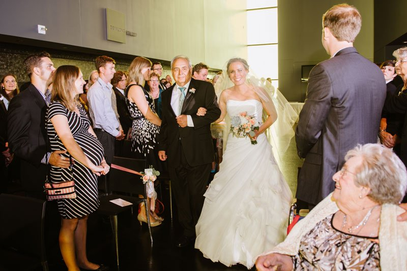 bride and father walk down aisle Guthrie theater minneapolis mn