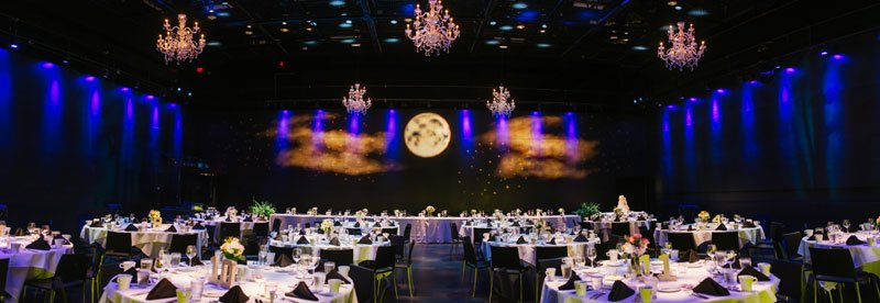 panorama of room with moon lights at wedding reception at Guthrie theater minneapolis mn