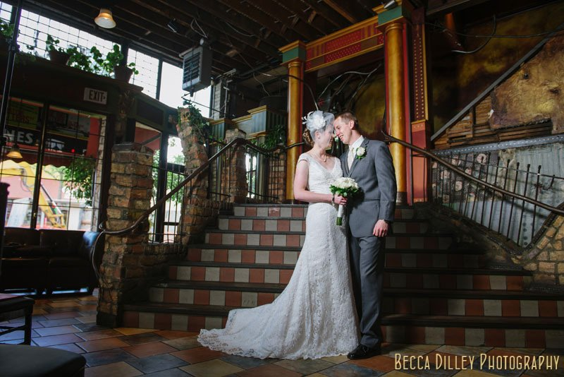 bride and groom at stairs in loring pasta bar minneapolis wedding
