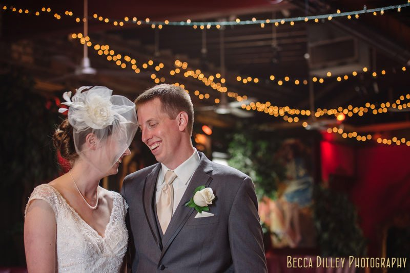 bride and groom with cafe lights at loring pasta bar minneapolis wedding