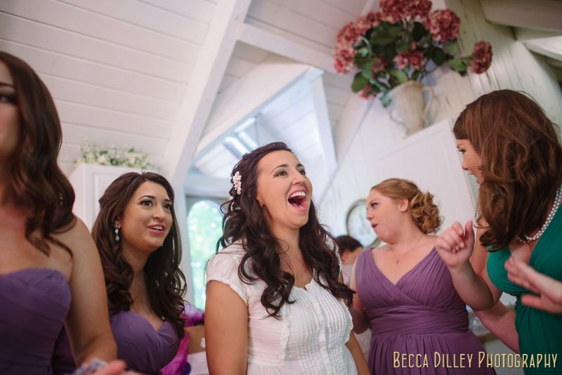 bride laughing at woods chapel wedding orono mn