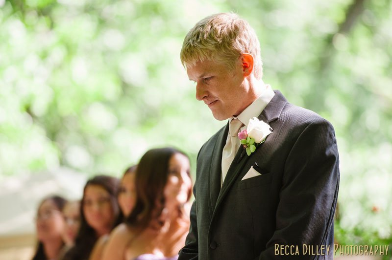 groom waits for bride before woods chapel wedding orono mn