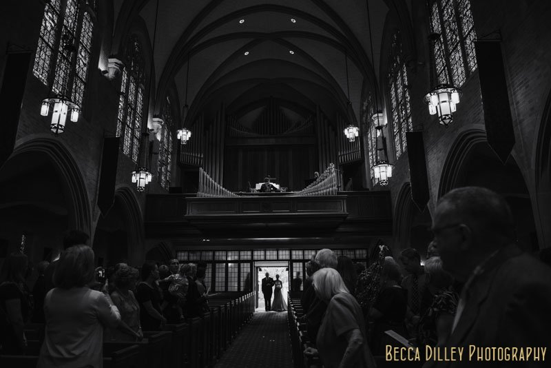 Bride and father pause at end of aisle before Bethlehem Lutheran Church wedding minneapolis mn