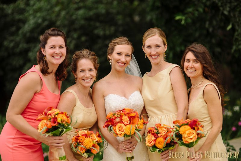bride with bridesmaids in champagne colored dresses st paul