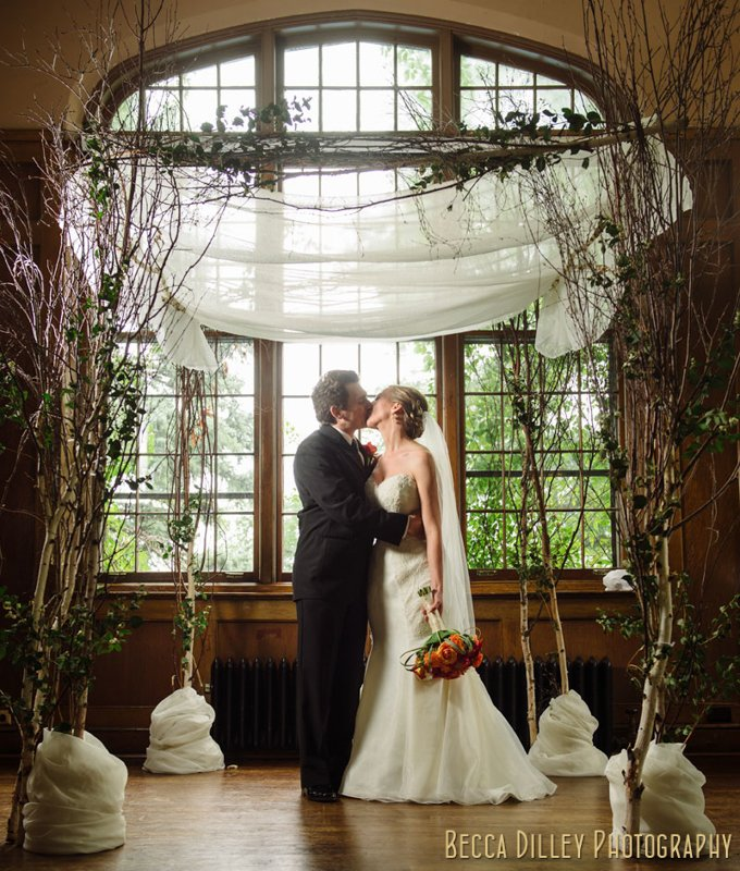 bride and groom under chuppah at st paul university club